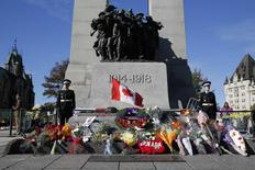 Sentries return to the Tomb of the Unknown Soldier during a ceremony at the National War Memorial in Ottawa October 24, 2014.   REUTERS/Blair Gable