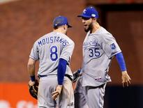 Oct 24, 2014; San Francisco, CA, USA; Kansas City Royals infielders Mike Moustakas (8) and Eric Hosmer (35) celebrate after defeating the San Francisco Giants during game three of the 2014 World Series at AT&T Park. Mandatory Credit: Kelley L Cox-USA TODAY Sports