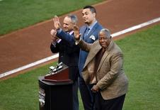 Oct 25, 2014; San Francisco, CA, USA; Miami Marlins outfielder Giancarlo Stanton (middle) waves to the crowd as he is awarded the Hank Aaron Award by newly elected commissioner Rob Manfred (left) and Hank Aaron before game four of the 2014 World Series between the San Francisco Giants and the Kansas City Royals at AT&T Park. Mandatory Credit: Ed Szczepanski-USA TODAY Sports
