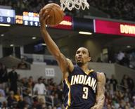 Oct 15, 2014; Cincinnati, OH, USA; Indiana Pacers guard George Hill (3) lays up against the Cleveland Cavaliers during the second half at the Cintas Center. The Cavaliers defeated the Pacers 98-93. Mandatory Credit: Frank Victores-USA TODAY Sports