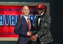 Jun 26, 2014; Brooklyn, NY, USA; Andrew Wiggins (Kansas) shakes hands with NBA commissioner Adam Silver after being selected as the number one overall pick to the Cleveland Cavaliers in the 2014 NBA Draft at the Barclays Center. Mandatory Credit: Brad Penner-USA TODAY Sports