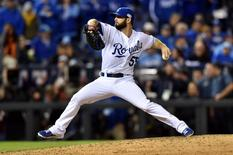 Kansas City Royals relief pitcher Tim Collins throws a pitch against the San Francisco Giants in the 9th inning during game six of the 2014 World Series at Kauffman Stadium. Peter G. Aiken-USA TODAY Sports