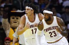 Cleveland Cavaliers forward LeBron James (R) and center Anderson Varejao run during their NBA Global Games Rio 2014 basketball game against Miami Heat in Rio de Janeiro October 11, 2014.  REUTERS/Sergio Moraes