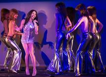 """Conchita Wurst performs in the number """"True Love?"""" on stage with topless dancers during a rehearsal for the show """"Desirs"""" at the Crazy Horse cabaret in Paris, October 30, 2014. REUTERS/Philippe Wojazer"""