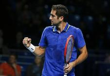 Croatia's Marin Cilic celebrates a point against Kazakhstan's Mikhail Kukushkin during their Kremlin Cup men's semi-final tennis match in Moscow October 18, 2014.  REUTERS/Grigory Dukor