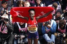 Mary Keitany of Kenya celebrates after winning the women's London Marathon April 22, 2012. REUTERS/Suzanne Plunkett