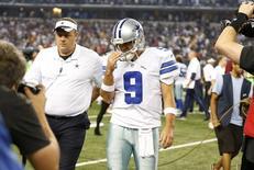 Oct 27, 2014; Arlington, TX, USA; Dallas Cowboys quarterback Tony Romo (9) walks off the field after the game against the Washington Redskins at AT&T Stadium. Mandatory Credit: Matthew Emmons-USA TODAY Sports