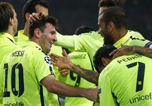 Jogador do Barcelona Lionel Messi comemora gol marcado em partida contra o Ajax em Amsterdã. 5/11/ 2014  REUTERS/Michael Kooren
