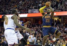 Cleveland Cavaliers forward LeBron James (23) shoots beside three New York Knicks in the third quarter at Quicken Loans Arena. Mandatory Credit: David Richard-USA TODAY Sports