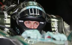 Mercedes Formula One driver Nico Rosberg of Germany sit on his car during the third practice session of the Brazilian Grand Prix in Sao Paulo November 8, 2014. The Brazilian Grand Prix will be held on Sunday. REUTERS/Nacho Doce