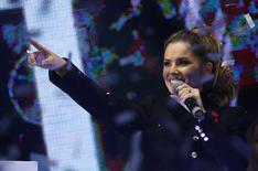 Singer Cheryl Fernandez-Versini reacts after switching on the Oxford Street Christmas Lights in London November 6, 2014.  REUTERS/Luke MacGregor