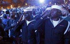 Sailors salute during the singing of the U.S. National Anthem at the Concert for Valor on the National Mall on Veterans' Day in Washington, November 11, 2014.       REUTERS/Jonathan Ernst