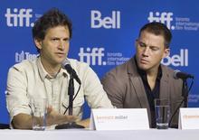 """Diretor Bennett Miller (E) e ator Channing Tatum falam sobre """"Foxcatcher"""" no Festival Internacional de Toronto. 8/9/2014  REUTERS/Fred Thornhill"""