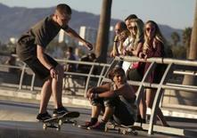 People watch a skateboarder at the Venice Skatepark in Venice, California November 7, 2014. REUTERS/Jonathan Alcorn