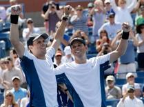 Sep 7, 2014; New York, NY, USA; Bob Bryan (USA) (right)  and Mike Bryan (USA) after beating Marcel Granollers (ESP) and Marc Lopez (ESP) in the men's doubles final of the 2014 U.S. Open tennis tournament at USTA Billie Jean King National Tennis Center. Mandatory Credit: Robert Deutsch-USA TODAY Sports