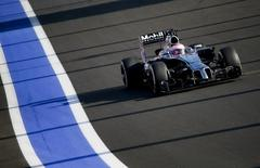 McLaren Formula One driver Jenson Button of Britain speeds during the first Russian Grand Prix in Sochi October 12, 2014.     REUTERS/Maxim Shemetov