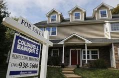 A real estate sign advertising a home for sale is pictured in Vienna, Virginia, outside of Washington, October 20, 2014.       REUTERS/Larry Downing