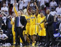 Indiana Pacers' Sam Young (3rd R) and teammates celebrate after Paul George made a game-tying three point shot to end regulation time during Game 1 of their NBA Eastern Conference final basketball playoff against the Miami Heat in Miami, Florida May 22, 2013. REUTERS/Joe Skipper