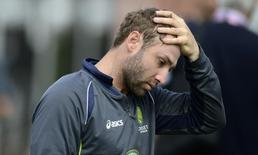 Australia's Phillip Hughes touches his head during a training session before Thursday's third Ashes cricket test match against England at Old Trafford cricket ground in Manchester July 30, 2013. REUTERS/Philip Brown (BRITAIN - Tags: SPORT CRICKET)