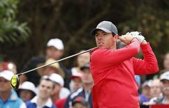 Northern Ireland's Rory McIlroy tees off from the 12th hole during the first round of the Australian Open golf tournament in Sydney, November 27, 2014.    REUTERS/Jason Reed