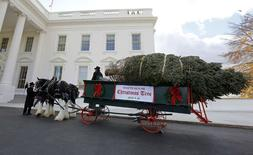The official White House Christmas tree, from the Crystal Spring Tree Farm in Pennsylvania, pulls up to the North Portico of the White House in Washington, November 28, 2014.  REUTERS/Larry Downing