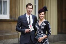 Wimbledon champion Andy Murray poses with his girlfriend Kim Sears, and his Officer of the Most Excellent Order of the British Empire (OBE) medal after receiving it from Prince William during an investiture ceremony at Buckingham Palace in London October 17, 2013. REUTERS/Paul Rogers
