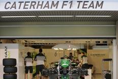 Members of the Caterham Formula One team prepare their car at the Yas Marina circuit before the start of the Abu Dhabi Grand Prix November 20, 2014. REUTERS/Caren Firouz