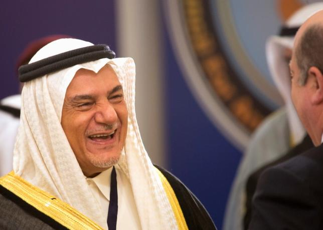 Saudi Arabian Prince Turki Al Faisal bin Abdulaziz smiles as he attends the opening ceremony of the first International Conference Of Council for Arab and International Relations, in Kuwait City February 11, 2013. REUTERS/Stephanie Mcgehee/Files