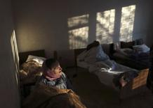 "Patients are seen in a room of the regional psycho-neurological hospital on the outskirts of Slovyanoserbsk, in a territory controlled by ""Lugansk People's Republic"" (LPR), eastern Ukraine, December 1, 2014. The Psycho-Neurological Hospital outside the village of Slovyanoserbsk is caught in the crossfire in separatist-held territory about 30 km (20 miles) northwest of the rebel stronghold of Luhansk and near the frontline. Medical workers say the head of the hospital was killed by a shell in Luhansk and about half the 180 staff have fled. There were 400 patients when fighting began, they say. Picture taken December 1, 2014. To match UKRAINE-CRISIS/HOSPITAL REUTERS/Antonio Bronic (UKRAINE - Tags: CONFLICT TPX IMAGES OF THE DAY HEALTH SOCIETY)"