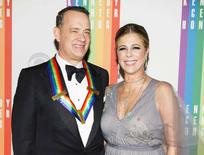 Actor Tom Hanks and his wife Rita Wilson arrive for the Kennedy Center Honors in Washington, December 7, 2014.      REUTERS/Joshua Roberts