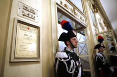 """Carabinieris stand inside La Scala opera house on the first day of opera season in downtown Milan December 7, 2014. """"Fidelio"""" of Ludwig van Beethoven, directed by Daniel Barenboim, will open for the 2014 opera season at opera house.  REUTERS/Alessandro Garofalo"""