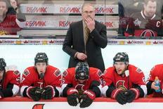 Nov 12, 2013; Ottawa, Ontario, CAN; Ottawa Senators coach Paul MacLean follows the action in the third period against the Philadelphia Flyers at the Canadian Tire Centre. Mandatory Credit: Marc DesRosiers-USA TODAY Sports