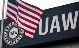 An American flag flies in front of the United Auto Workers union logo on the front of the UAW Solidarity House in Detroit, Michigan, September 8, 2011. REUTERS/Rebecca Cook
