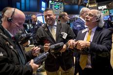 Traders work on the floor of the New York Stock Exchange December 5, 2014. REUTERS/Brendan McDermid