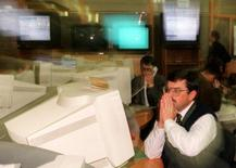 A Russian dealer watches a computer display at the Moscow Interbank Currency Exchange (MICEX) September 8. Rouble/dollar trade on the electronic system of the MICEX, used as a basis for fixing the exchange rate, was cancelled on Tuesday, a senior exchange official said.  MF/GB