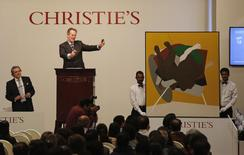 Christie's World Art head William Robinson (C) gestures as he auctions a painting by Indian artist Tyeb Mehta at an hotel in Mumbai, during Christie's second auction in India, December 11, 2014.  REUTERS/Shailesh Andrade