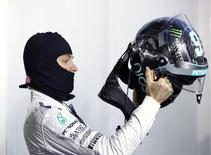 Mercedes Formula One driver Nico Rosberg of Germany puts on his helmet during the annual 'Stars & Cars' event in Stuttgart November 29, 2014.   REUTERS/Michaela Rehle