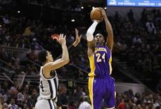 Dec 12, 2014; San Antonio, TX, USA; Los Angeles Lakers shooting guard Kobe Bryant (24) shoots the ball as San Antonio Spurs shooting guard Danny Green (14) defends during the second half at AT&T Center. Mandatory Credit: Soobum Im-USA TODAY Sports - RTR4HUCJ