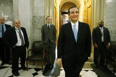 U.S. Senator Ted Cruz (R-TX) (2nd R) smiles as he departs the Senate floor after it passed at $1.1 trillion spending bill following a long series of votes, many on procedural matters or to confirm members of the Obama administration, at the U.S. Capitol in Washington December 13, 2014. REUTERS/Jonathan Ernst