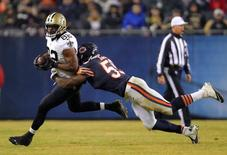 New Orleans Saints tight end Benjamin Watson (82) is tackled by Chicago Bears inside linebacker Christian Jones (59) during the second half at Soldier Field. New Orleans won 31-15. Mandatory Credit: Dennis Wierzbicki-USA TODAY Sports