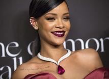 La cantante Rihanna en un evento en Beverly Hills, dic 11 2014. El grupo alemán Puma designó el martes a la cantante de pop Rihanna como directora creativa de su colección femenina, en la más reciente decisión de una firma deportiva de aprovechar el crecimiento de ese segmento.  REUTERS/Mario Anzuoni