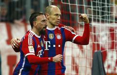 Bayern Munich's Franck Ribery and Arjen Robben (R) celebrate after Robbern scored a goal during their German first division Bundesliga soccer match against Freibrug in Munich December 16, 2014.    REUTERS/Michael Dalder (GERMANY - Tags: SOCCER SPORT) DFL RULES TO LIMIT THE ONLINE USAGE DURING MATCH TIME TO 15 PICTURES PER GAME. IMAGE SEQUENCES TO SIMULATE VIDEO IS NOT ALLOWED AT ANY TIME. FOR FURTHER QUERIES PLEASE CONTACT DFL DIRECTLY AT + 49 69 650050.