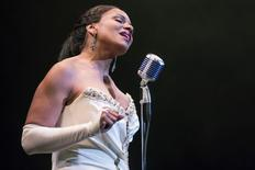 """Audra McDonald performs as Billie Holiday in the production of """"Lady Day at Emerson's Bar and Grill"""" at the Circle in the Square Theatre in New York, March 24, 2014.  REUTERS/Andrew Kelly"""