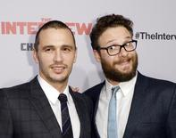 """Cast members James Franco (L) and Seth Rogen pose during premiere of the film """"The Interview"""" in Los Angeles, California in this December 11, 2014 file photo.  REUTERS/Kevork Djansezian/Files"""