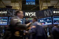 Traders work on the floor of the New York Stock Exchange December 16, 2014. REUTERS/Brendan McDermid