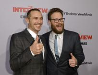 """Cast members James Franco (L) and Seth Rogen pose during premiere of the film """"The Interview"""" in Los Angeles, California December 11, 2014.  REUTERS/Kevork Djansezian"""