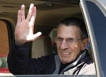 """Actor Leonard Nimoy gives the """"Vulcan salute"""" to the crowd while riding in a parade in the town of Vulcan, Alberta April 23, 2010. REUTERS/Todd Korol"""