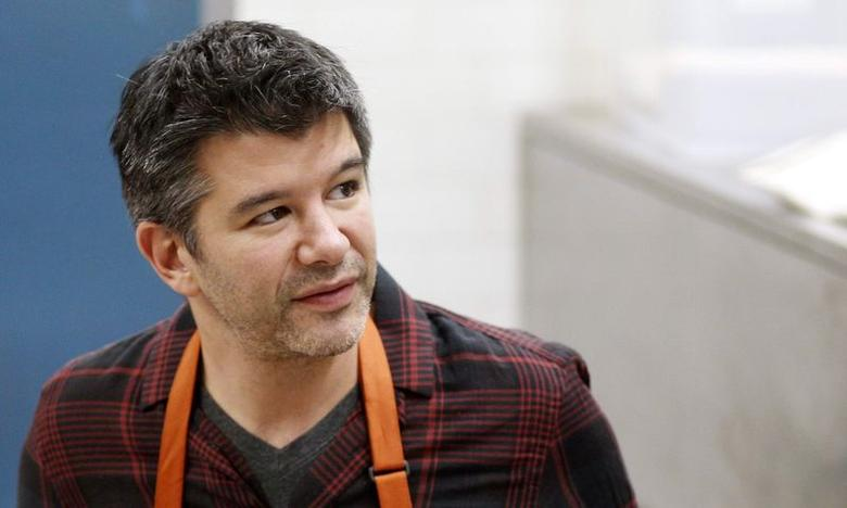 Uber Chief Executive Officer (CEO) Travis Kalanick works with fourth graders during Cooking Matters, a nutrition class taught by 18 Reasons, a local partner of Share our Strength at Glen Park Elementary School in San Francisco, California, December 10, 2014. REUTERS/Beck Diefenbach