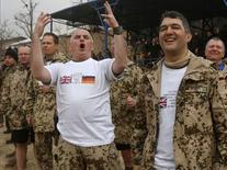 German fans react during a football match between British and German troops commemorating the Christmas Truce of 1914, at the ISAF Headquarters in Kabul December 24, 2014.  REUTERS/Omar Sobhani