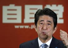 Japan's Prime Minister and the leader of the ruling Liberal Democratic Party (LDP), Shinzo Abe, attends a news conference following a victory in the lower house elections by his ruling coalition, at the LDP headquarters in Tokyo December 15, 2014. REUTERS/Toru Hanai